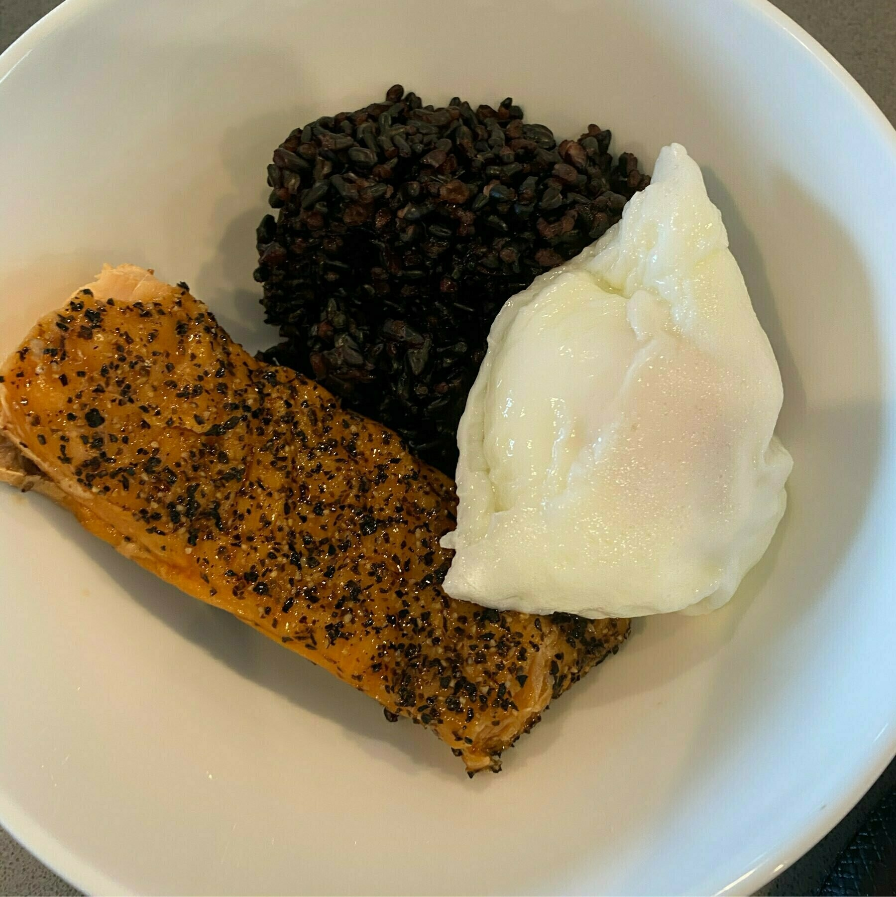 Forbidden rice, roasted salmon, and a poached egg.