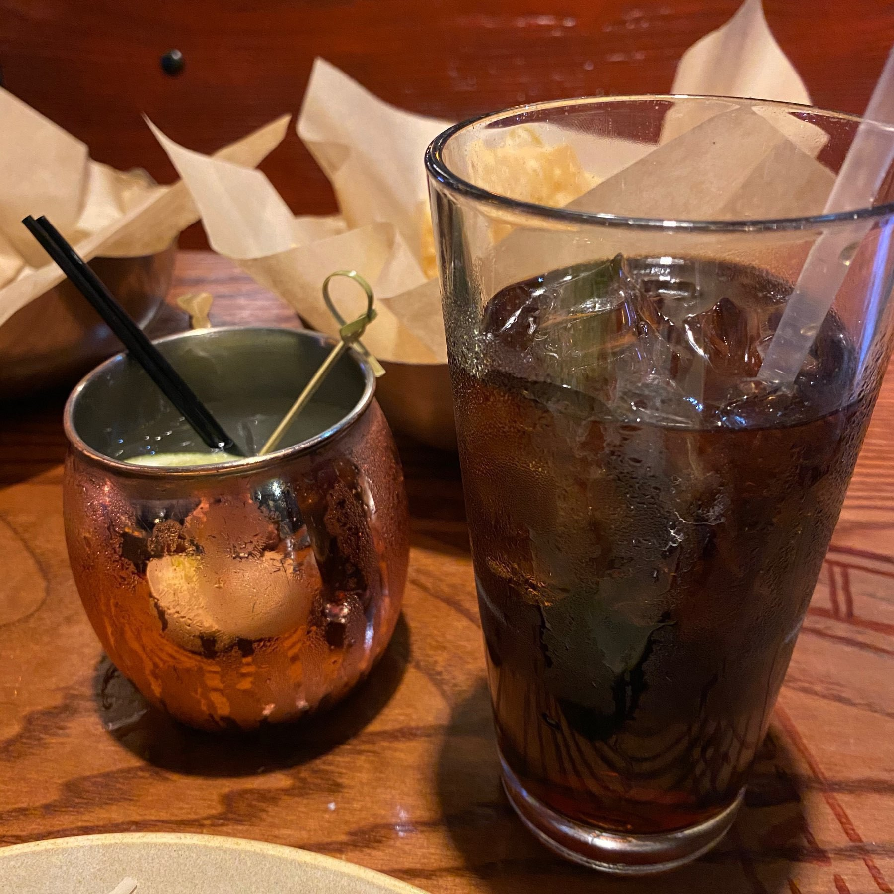 An alcoholic drink next to a Diet Coke.