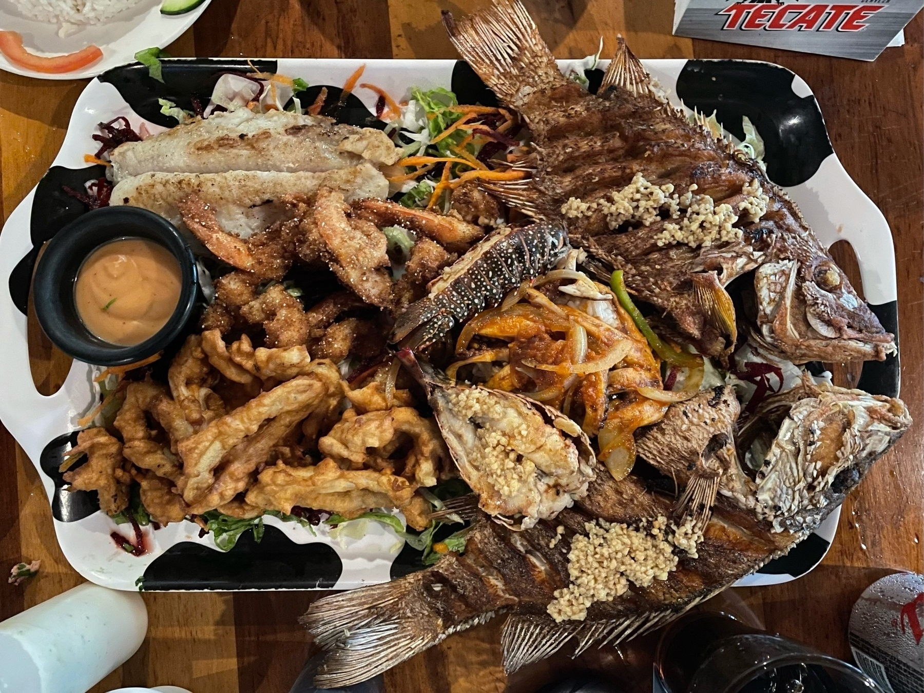 Fish platter with calamari, fried whole fish, filet of fish, lobster tails, shrimp, and more