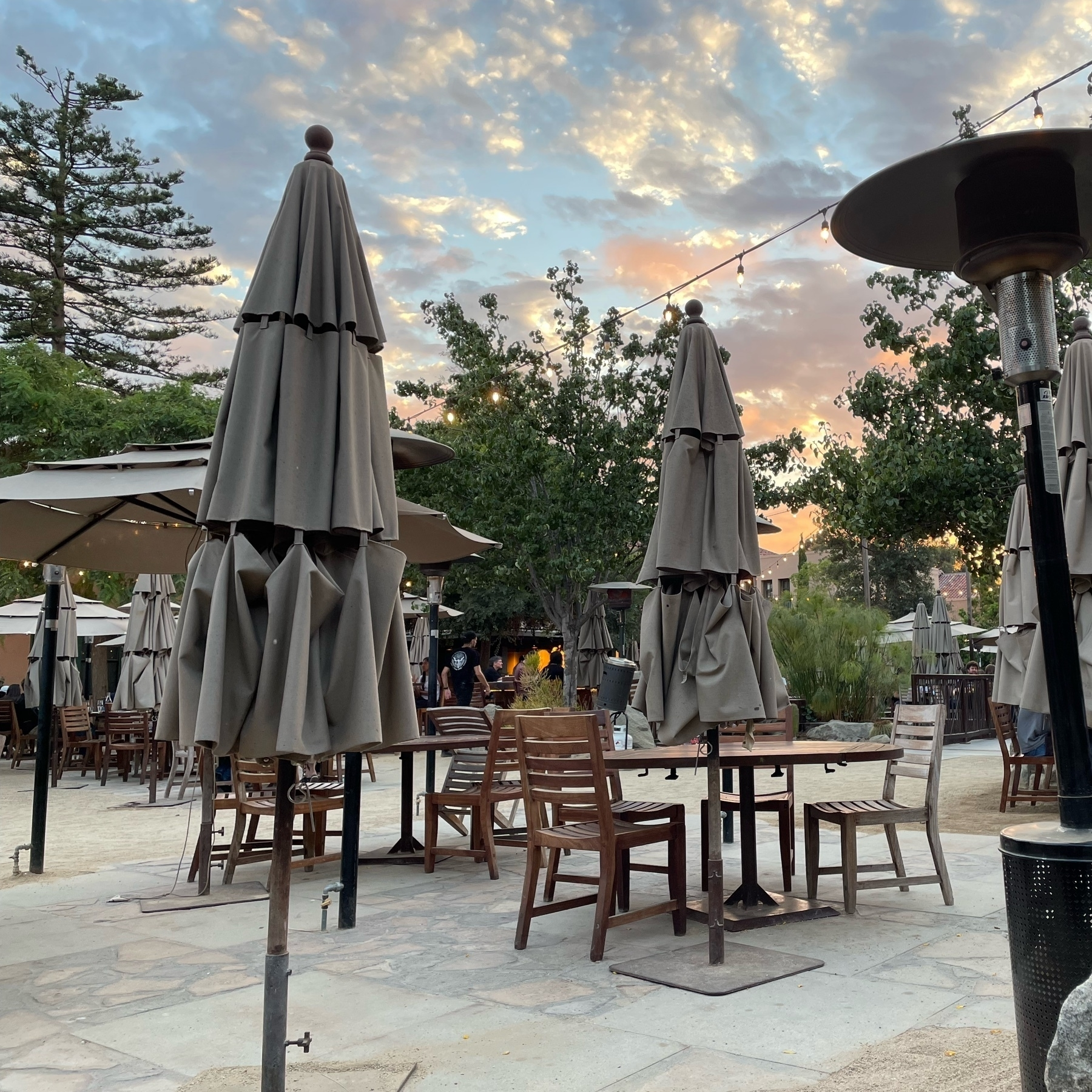 A picture of empty tables outside at Stone Brewing