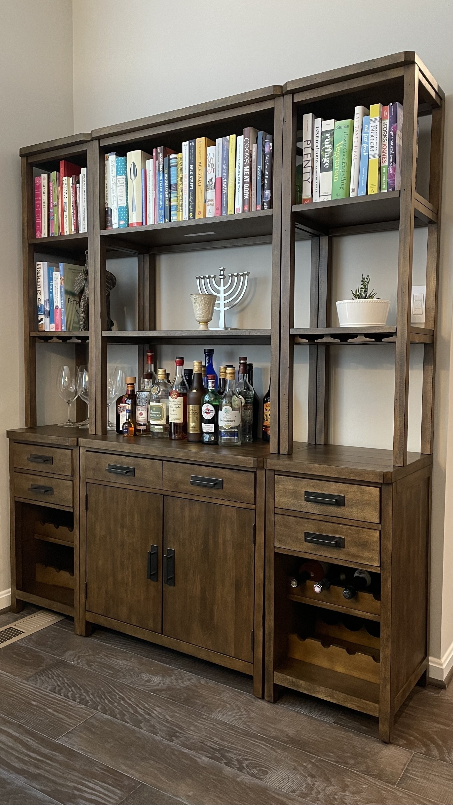 Pottery Barn Matteo Bar set with books along the top row.
